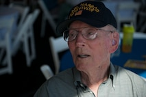 Lenoard Nielson, sits and watches the Aviation Nation air show held at Nellis Air Force Base, Nev., Nov. 12. Nielson is one of the few Pearl Harbor suvivors still around in Nevada. During Pearl Harbor he was aboard the USS Solace and helped assist those who were injured. (U.S. Air Force photo by Senior Airman Rachel Loftis/released)
