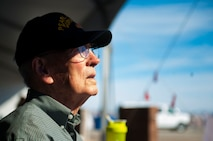 Lenoard Nielson, watches as an aircraft passes by during the Aviation Nation air show at Nellis Air Force Base, Nev., Nov. 12. Nielson is a 94 year old Pearl Harbor survivor. He was a Navy Lt. Junior Grade ship vetter. He was a part of a group of people trained in firefighting, damage control to the ship and making all the repairs possible to keep the ship afloat if it was damaged. (U.S. Air Force photo by Senior Airman Rachel Loftis/released)