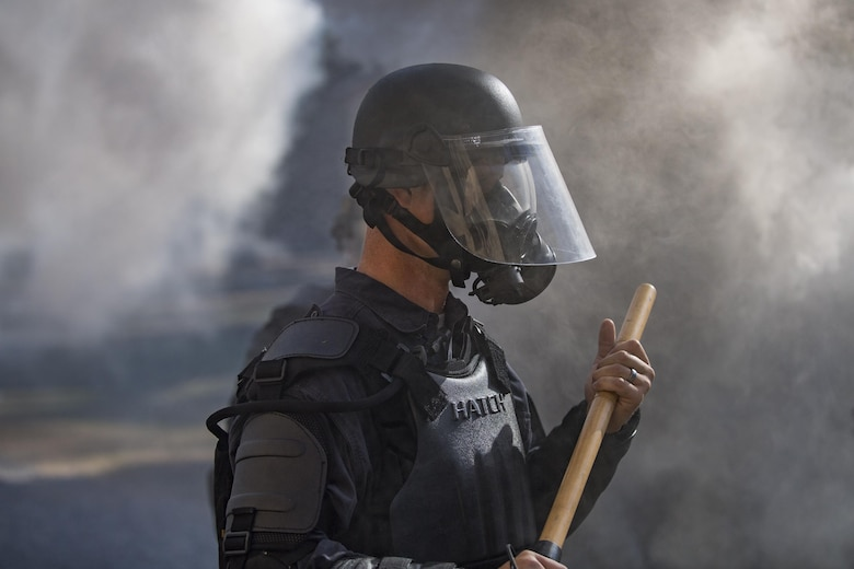 A member of Georgia State Patrol's Mobile Field Force stands in the haze of smoke grenades, Nov. 16, 2016, at Moody Air Force Base, Ga. Moody facilitated this training by providing the Military Operations in Urban Terrain village, a training area consisting of buildings, obstacles and gravel roads. (U.S. Air Force photo by Airman 1st Class Daniel Snider)