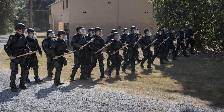 Georgia State Patrol's Mobile Field Force create a wall of police officers as they march forward, Nov. 16, 2016, at Moody Air Force Base, Ga. The GSP conducts semiannual riot control training to ensure readiness if a situation arises. (U.S. Air Force photo by Airman 1st Class Daniel Snider)
