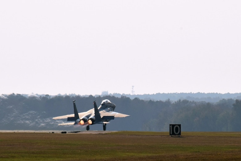 Maj. Adam Mattheis, 335th Fighter Squadron F-15E Strike Eagle pilot, takes off during a familiarization flight with Gen. Petr Pavel, NATO military committee chairman, Nov. 15, 2016, at Seymour Johnson Air Force Base, North Carolina. During the flight, Pavel experienced different aircraft handling maneuvers, and saw the Air Force Dare Bomb Range, which is primarily used for training, and is an electronic combat, day-night, and air-to-ground training site critical to Seymour Johnson AFB and Army and Navy special operations teams. (U.S. Air Force photo by Airman Miranda A. Loera)