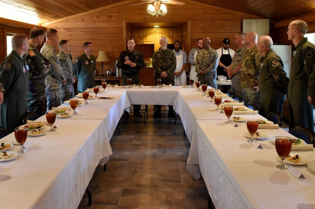 Col. Christopher Sage, 4th Fighter Wing commander, introduces Gen. Petr Pavel, NATO military committee chairman, during a lunch meeting, Nov. 15, 2016, at Seymour Johnson Air Force Base, North Carolina. Pavel is the first leader from a former Warsaw Pact nation to serve as NATO's senior military officer. (U.S. Air Force photo by Airman Miranda A. Loera)