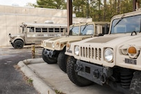 A mobile command post and Humvees belonging to the Lenoir County Sheriff's office sit in the motor pool of a underutilized U.S. Army Reserve Center in Kinston, N.C., Nov. 2, 2016. After Hurricane Matthew flooded the courthouse basement in early October, the sheriff's office reached out to the 81st Regional Support Command who owned the center at the Kinston airport. Through the National Defense Authorization Act of 2012, U.S. Army Reserve Defense Support of Civil Authorities and Stafford Act (Disaster and Emergency Act), the sheriff's office was able to use the facility to continue to serve the citizens of Lenoir County.  (U.S. Army photo by Timothy L. Hale)(Released)