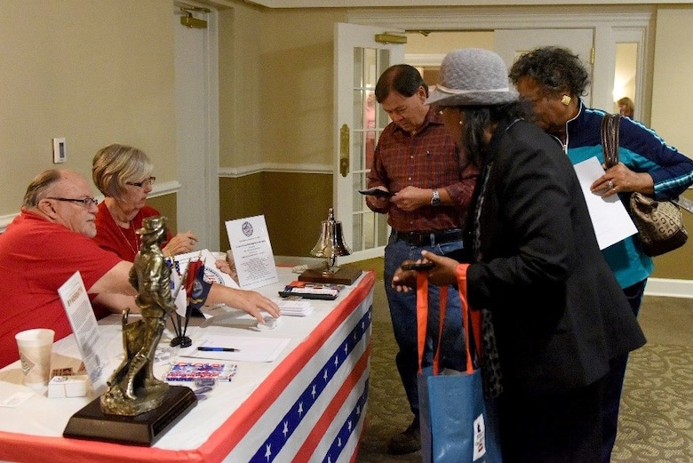 Retired service members visit various information booths during the second annual Retiree Appreciation Night event, Nov. 10, 2016, at Seymour Johnson Air Force Base, North Carolina.  The event was held in appreciation for retirees' service to the country in conjunction with Veterans Day and to distribute information about base services available to them.  (U.S. Air Force photo by Airman Miranda A. Loera)