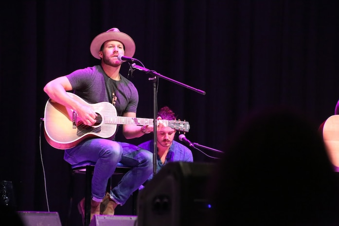 Drake White performs during the 8th annual Guitar Pull at Marine Corps Air Station Cherry Point, N.C. Nov. 16, 2016. More than 1,800 Marines, Sailors and members of the community came together to enjoy a free concert with musical artists like Trace Adkins, Jerrod Niemann, Josh Turner and more. The event brought forth an opportunity for service members and locals to interact with each other in a unique environment. White is a country music artist performing at the Guitar Pull. (U.S. Marine Corps photo by Sgt. N.W. Huertas/ Released)