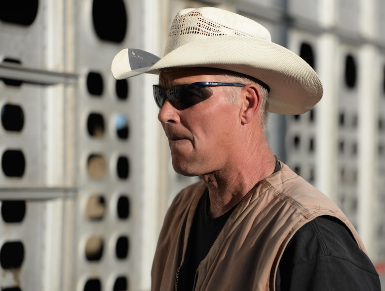 """Ed Broskey, 9th Civil Engineer Squadron biological science technician, waits to unload a herd of cattle from a trailer Nov. 2, 2016, at Beale Air Force Base, California. Broskey has been working with cattle for 18 years and is known as the """"Government Cowboy."""" (U.S. Air Force photo/Airman Tristan D. Viglianco)"""