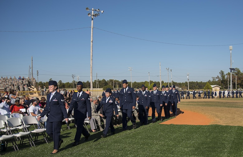 A long line of Airmen in service dress march toward their seats during a Community College of the Air Force graduation ceremony at Eglin Air Force Base, Fla., Nov. 16.  More than 300 Airmen from Eglin and Duke Field were honored at this year's event. (U.S. Air Force photo/Samuel King Jr.)
