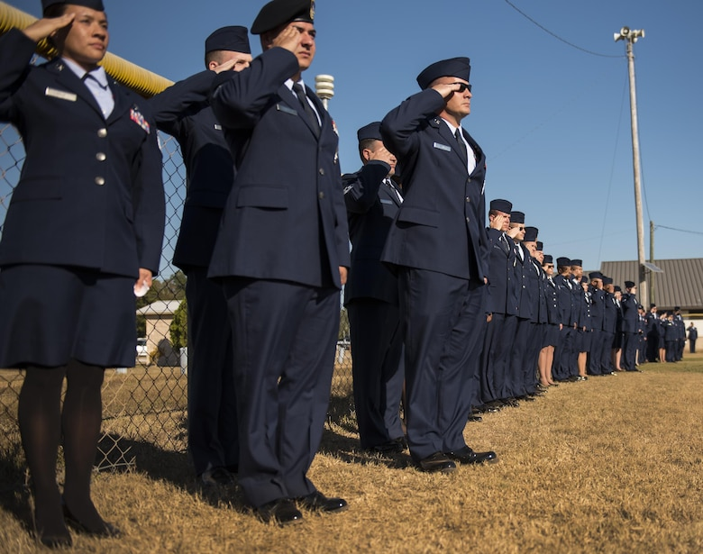 Airmen salute during the playing of the National Anthem prior to their entrance at the beginning of the Community College of the Air Force graduation ceremony at Eglin Air Force Base, Fla., Nov. 16.  More than 300 Airmen from Eglin and Duke Field were honored at this year's event. (U.S. Air Force photo/Samuel King Jr.)