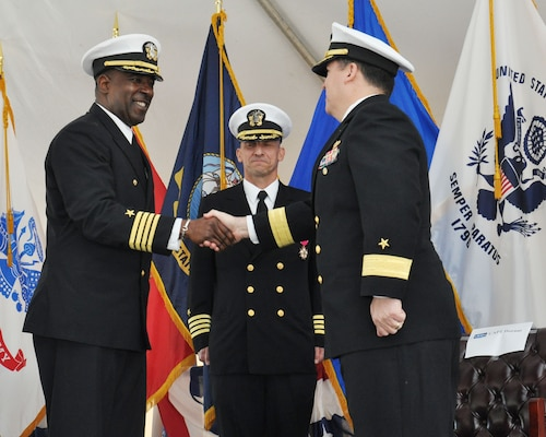 Capt. Godfrey Weekes, left, incoming commanding officer of the Naval Surface Warfare Center Dahlgren Division (NSWCDD), greets Rear Adm. Tom Druggan, right, commander of the Naval Surface Warfare Center (NSWC), and Capt. Brian Durant, center, outgoing commanding officer of NSWCDD, during a change of command ceremony Nov. 18 at Naval Support Facility (NSF) Dahlgren.