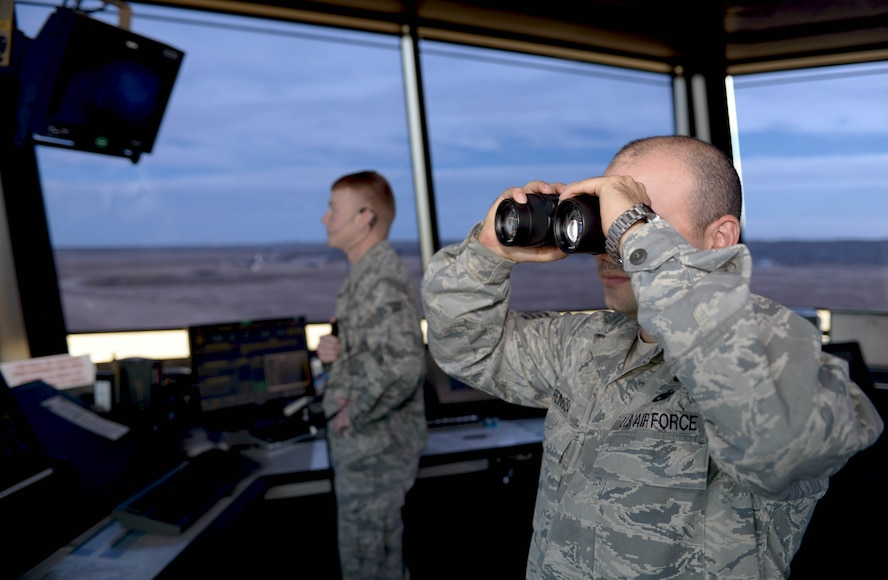 Staff Sgt. Yoendri Reinosa and Senior Airman Clinton Bruce, air traffic controllers assigned to the 28th Operations Support Squadron, watch as a B-1 bomber takes off at Ellsworth Air Force Base, S.D., Nov. 16, 2016. Basic duties of air traffic controllers include clearing aircraft, clearance deliveries and ensuring flight safety. (U.S. Air Force photo by Airman 1st Class Donald C. Knechtel)