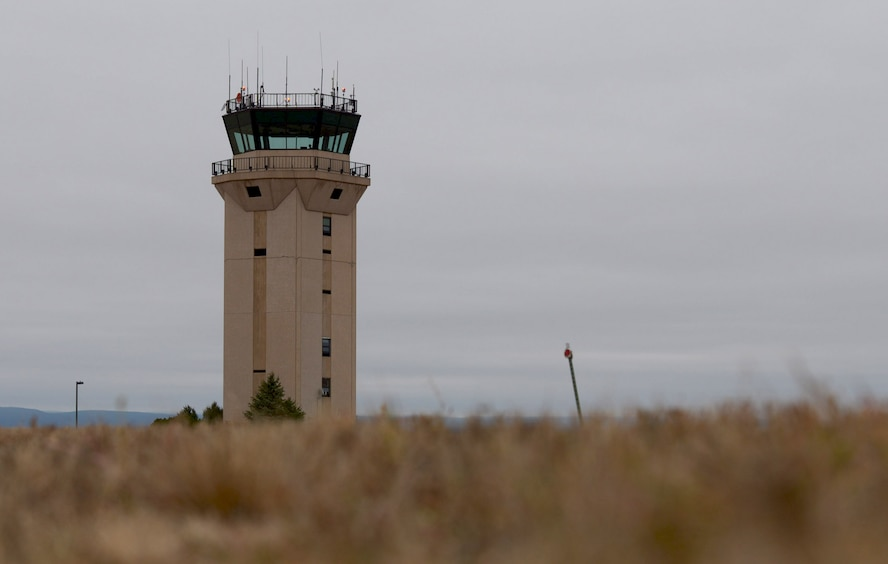 Air traffic controllers, assigned to the 28th Operations Support Squadron, coordinate with aircraft at Ellsworth Air Force Base, S.D., Nov. 17, 2016. The Air Traffic Control Tower provides flight safety for all incoming and outgoing aircraft. (U.S. Air Force photo by Airman 1st Class Donald C. Knechtel)