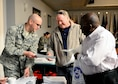 Maj. Jason Bingham, 14th Medical Support Squadron, hands Air Force retirees Walt Boltwood and Joe Smith information about upcoming changes to the pharmacy health insurance policy Nov. 16, 2016, at Columbus Air Force Base, Mississippi. During the event attendees were able to learn about a variety of programs in place to support them, including the retiree affairs office, Koritz Clinic, Airman and Family Readiness services, and the base commissary upgrade project. Afterwards retirees were able to gather pamphlets, fill out medical cards, and receive free flu shots. (U.S. Air Force photo by 1st Lt. Lauren Woods)