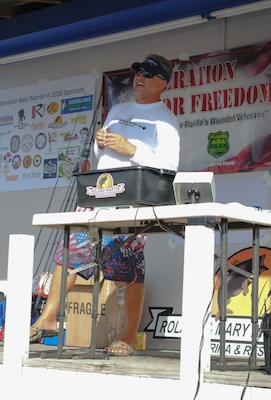 CLEWISTON, Fla. (Nov. 6, 2016) Central Command (CENTCOM) communications branch (J6) chief, Thomas Loftis welcomes guests to the Operation Bass Warrior fishing tournament.Loftis organized the event with a network of friends and family as a way of giving back to those who served and sacrificed.(Courtesy photo)
