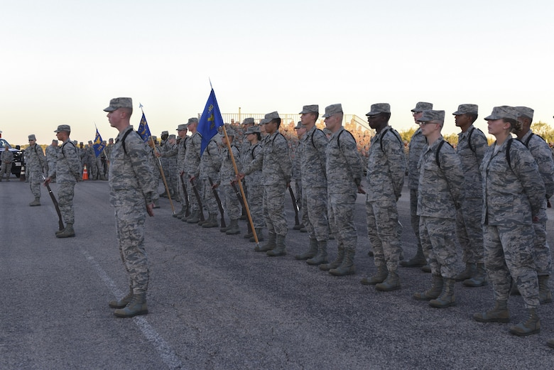 The 312th Training Squadron, 315th Training Squadron and 316th Training Squadron Airmen stand to hear the winners of the 17th Training Group Drill Competition at the flight line on Goodfellow Air Force Base, Texas, Nov. 16, 2016. The 17th TRG held the competition to find the best drill team. (U.S. Air Force photo by Airman 1st Class Chase Sousa/Released)