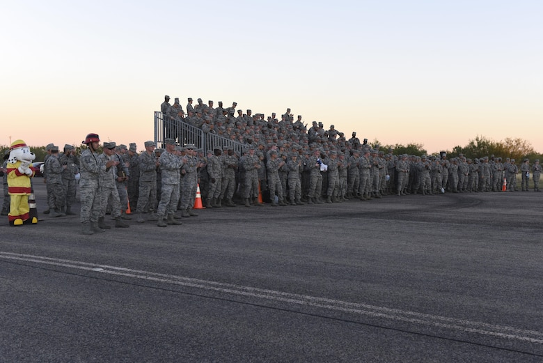 Airmen from the 315th Training Squadron stand to witness the drill competition at the flight line on Goodfellow Air Force Base, Texas, Nov. 16, 2016. The 316th Training Squadron won the competition. (U.S. Air Force photo by Airman 1st Class Chase Sousa/Released)