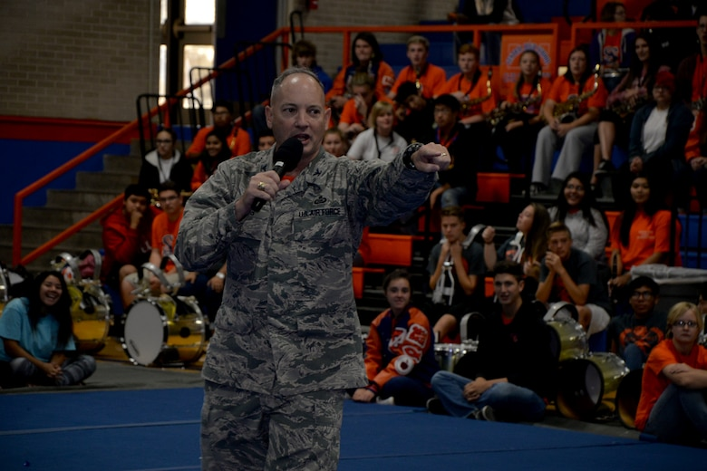 U.S. Air Force Col. Michael Downs, 17th Training Wing Commander, speaks at a school pep-rally at Central High School in San Angelo, Texas, Nov. 18, 2016. Downs presented a flag flown over Goodfellow Air Force Base headquarters to the San Angelo Central High School football team as they enter the second round of the Texas state football playoffs. (U.S. Air Force photo by Airman 1st Class Randall Moose/Released)