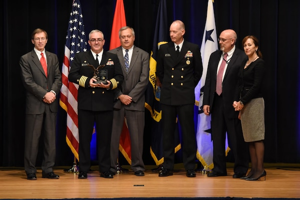 Capt. Michael Ladner, program manager Surface Ship Weapons holds his Program Manager of the Year award during the 2016 Department of the Navy Acquisition Excellence Awards ceremony at the Pentagon, Nov. 17.