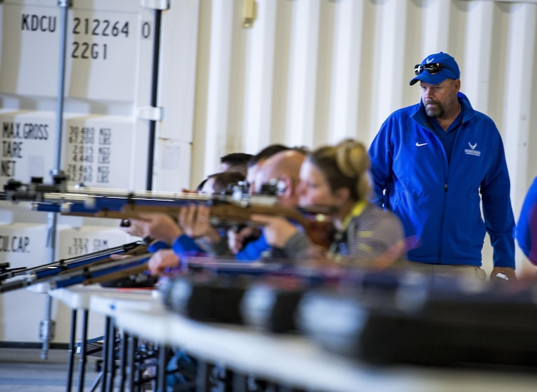 Dan Duitsman, the Air Force Wounded Warrior Program shooting head coach, watches as participants fire air rifles at the Northeast Warrior CARE Event on Joint Base Andrews, Md., Nov. 18, 2016. The AFW2 regional CARE event provided a holistic opportunity for wounded warriors to enhance the four domains -- physical, mental, spiritual and social – of Comprehensive Airman Fitness. (U.S. Air Force photo/Staff Sgt. Christopher Gross)