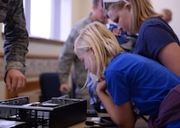 Students from local elementary schools examine different parts of a computer tower during the science, technology, engineering and math fair, Nov. 17, 2016, at Altus Air Force Base, Okla. The STEM fair brought together 5th grade students and teachers, showcasing STEM to local students and how those subjects can relate to different Air Force careers. (U.S. Air Force photo by Airman 1st Class Cody Dowell/Released)