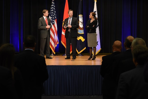 Assistant Secretary of the Navy (Research, Development and Acquisition) Sean Stackley (left) presented Naval Sea Systems Command's Mike Gutermuth the Rear Admiral Wayne E. Meyer Memorial Award as Janine Anne Davidson, Under Secretary of the United States Navy looks on during the 2016 Department of the Navy Acquisition Excellence Awards at the Pentagon, Nov. 17.