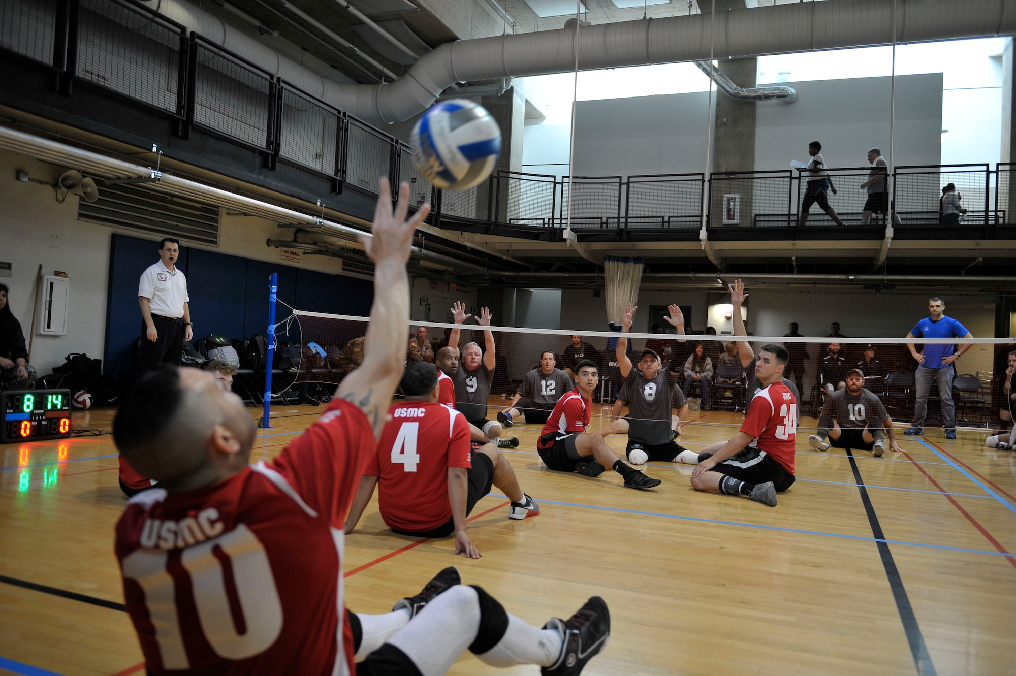 The Marine and U.S. Special Operations Command wounded warrior teams face off during the joint-service Warrior CARE Month Sitting Volleyball Tournament at the Pentagon Nov. 17, 2016. November is Warrior CARE Month.  CARE stands for Caregiver Support Program, Adaptive and Rehabilitative Sports Program, Recovering Airmen Mentorship Program, and Employment and Career Readiness Program. (U.S. Air Force photo/Tech. Sgt. Robert Barnett)