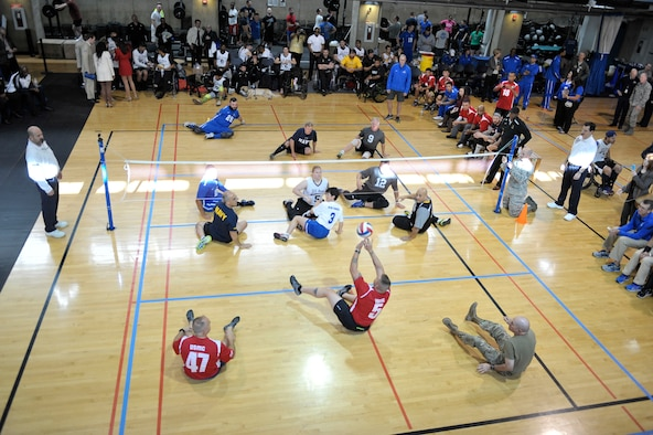 Wounded warrior athletes from the Army, Air Force, Navy and Marines compete against senior military leaders in the joint-service Warrior CARE Month Sitting Volleyball Tournament at the Pentagon Nov. 17, 2016. The warrior CARE event offers participants caregiver support and recovering Airmen mentorship, training and adaptive and rehabilitative sports training. CARE stands for Caregiver Support Program, Adaptive and Rehabilitative Sports Program, Recovering Airmen Mentorship Program, and Employment and Career Readiness Program. (U.S. Air Force photo/Tech. Sgt. Robert Barnett)