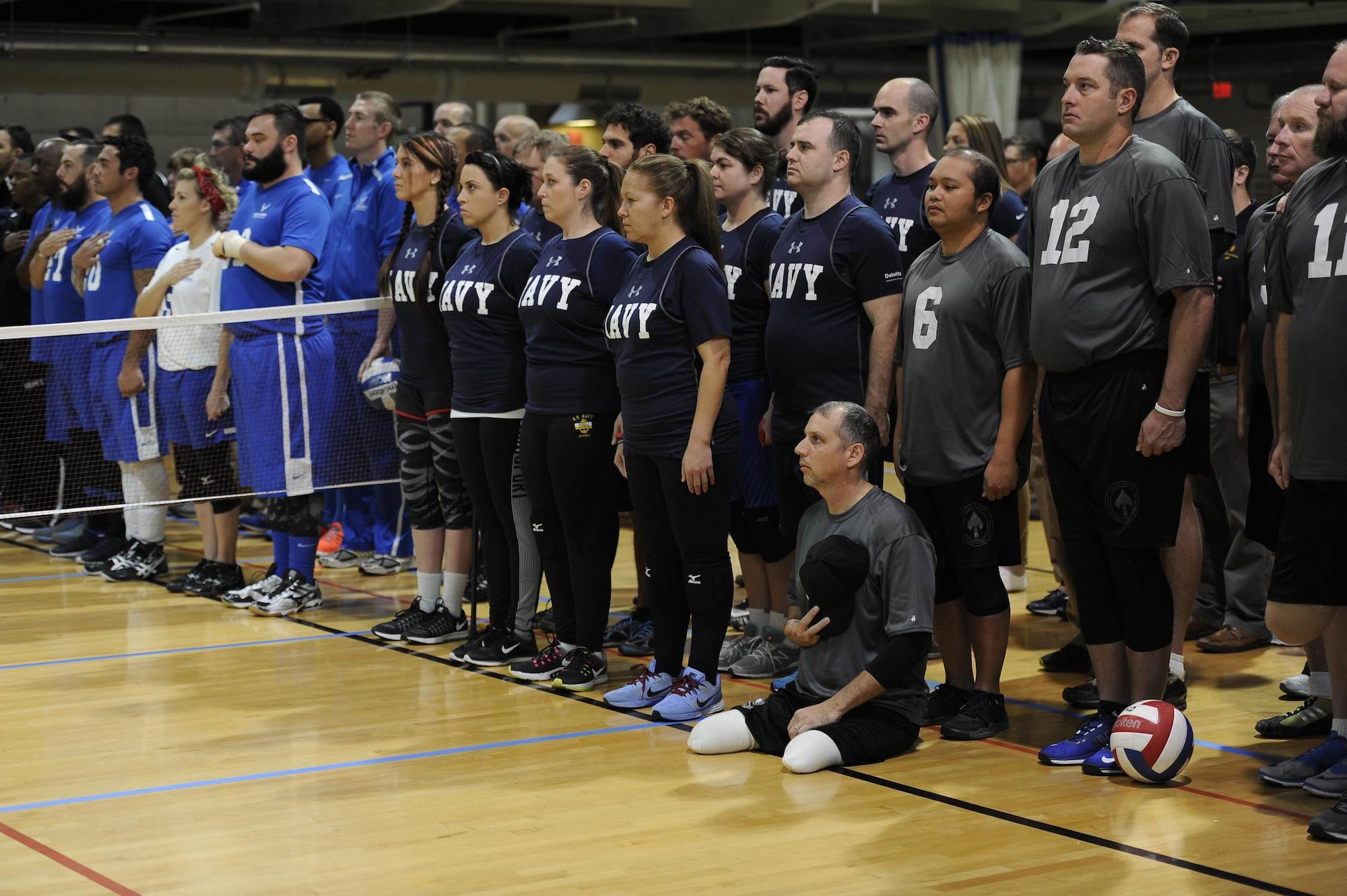 Wounded warrior athletes from the Army, Air Force, Navy and Marines prepare for the joint-service Warrior CARE Month Sitting Volleyball Tournament at the Pentagon Nov. 17, 2016. The warrior CARE event offers participants caregiver support and recovering Airmen mentorship, training and adaptive and rehabilitative sports training. CARE stands for Caregiver Support Program, Adaptive and Rehabilitative Sports Program, Recovering Airmen Mentorship Program, and Employment and Career Readiness Program. (U.S. Air Force photo/Tech. Sgt. Robert Barnett)