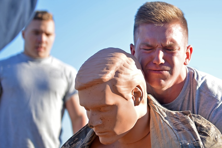 A U.S. Airman assigned to the 20th Civil Engineer Squadron transports a simulated injured wingman during a Firefighter Combat Challenge 5K run at Shaw Air Force Base, S.C., Nov. 18, 2016. Participants were tasked with transporting the almost 250 pound mannequin approximately 100 meters. (U.S. Air Force photo by Airman 1st Class Christopher Maldonado)