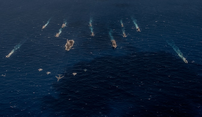 A B-1 bomber from the 34th Expeditionary Bomb Squadron leads a formation with fighters in front of U.S. Navy and Japanese surface vessels during Exercise Keen Sword 17, which took place Oct. 30 to Nov. 11, 2016, in the Pacific Ocean off the coasts of Japan, Guam and the Northern Mariana Islands. Keen Sword is a bilateral exercise between the Japanese Self-Defense Force and the United States designed to strengthen the Japan-U.S. alliance and increase combined combat readiness within the framework of the alliance. (U.S. Navy photo by MC3 Nathan Burke)