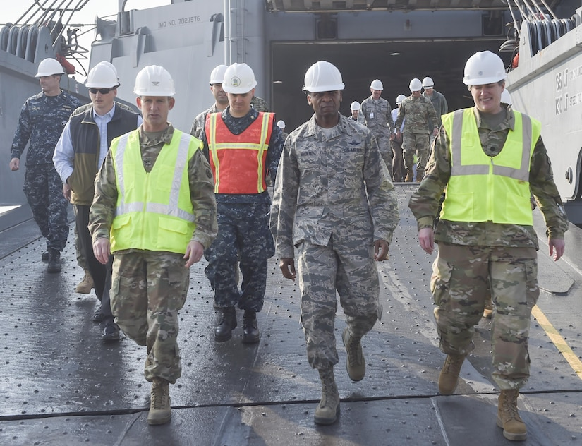 U.S. Air Force Gen. Darren W. McDew, U.S. Transportation Command commander, center, exits MV Cape Edmund (AKR-5069) Nov.16, 2016, at Joint Base Charleston - Weapons Station, South Carolina. The tour showcased Joint Task Force Port Opening for seaport of debarkation capabilities. The tour was part of the U.S. TRANSCOM Component Commanders conference.