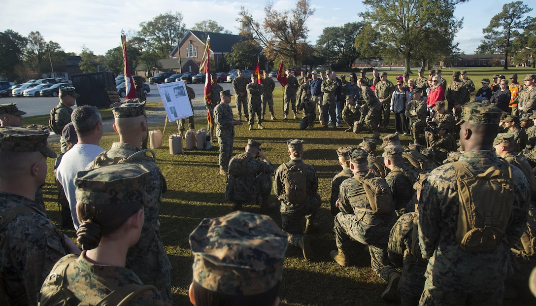 U.S. Marine Corps Staff Sgt. Markus Green, front left, career planner, Headquarters and Support Battalion (H&S Bn), Marine Corps Installations East, Marine Corps Base Camp Lejeune (MCIEAST, MCB CAMLEJ) gives a period of military instruction during a hike on Camp Lejeune, Nov. 14, 2016. H&S Bn, MCIEAST, MCB CAMLEJ conducted a 7.5 mile motivational and educational hike in recognition of the 75th anniversary of Camp Lejeune.