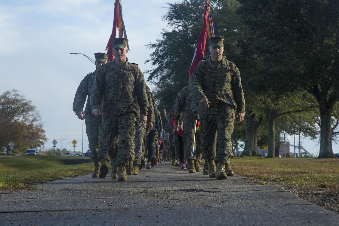 U.S. Marines with Headquarters and Support Battalion (H&S Bn), Marine Corps Installations East, Marine Corps Base Camp Lejeune (MCIEAST, MCB CAMLEJ) conduct a hike on Camp Lejeune, Nov. 14, 2016. H&S Bn, MCIEAST, MCB CAMLEJ conducted a 7.5 mile motivational and educational hike in recognition of the 75th anniversary of Camp Lejeune.