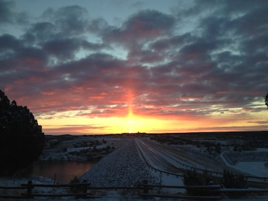 SANTA ROSA DAM, N.M. – A wintery sunrise at the dam, Feb. 3, 2016. Photo by Rowena Sanchez. This 2016 Photo Drive entry tied for third place based on employee voting.