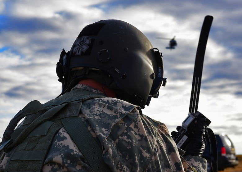 A soldier from the South Dakota National Guard's Company C, 1st Battalion, 189th Aviation Regiment, radios for extraction from a simulated crash site near Belle Fourche, S.D., Nov. 16, 2016. Various air and ground units coordinated the rescue as part of Exercise Combat Raider 1701. (U.S. Air Force photo by Airman 1st Class James L. Miller)