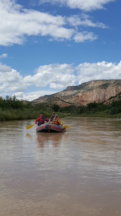 Along the Chama River, N.M. – (l-r): Abiquiu Lake park ranger Nathaniel Naranjo; Mike Harvey, raft guide with TetraTech; and Ryan Gronewald in the District's Reservoir Control Branch, participate in an interagency raft trip down the Rio Chama, Aug. 26, 2016. Photo by LeeAnn Summer. This was a 2016 Photo Drive entry.