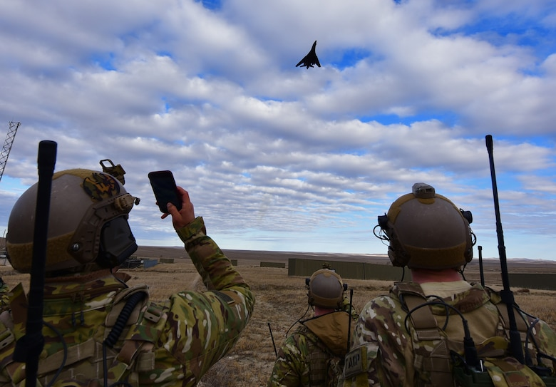 A B-1 bomber from Ellsworth Air Force Base, S.D., performs a show-of-force flyover as part of a joint-exercise rescue near Belle Fourche, S.D., Nov. 16, 2016. Combat Raider 1701 is a joint-exercise to maintain interoperability between air support and ground troops. (U.S. Air Force photo by Airman 1st Class James L. Miller)