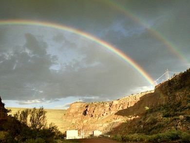 ABIQUIU DAM, N.M – Looking up from the downstream side of the dam alongside the Rio Chama, two rainbows appear in the sky after a passing storm, Sept. 1, 2016. Photo by Clarence Maestas. This 2016 Photo Drive entry tied for second place based on employee voting.