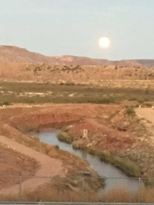 CONCHAS LAKE, N.M. – The full moon shines bright over the canal coming out from the irrigation headworks at the dam, Oct. 15, 2016. Photo by Nadine Carter. This was a 2016 Photo Drive entry.