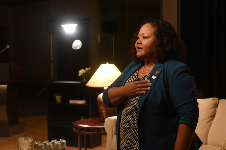 "PETERSON AIR FORCE BASE, Colo. – Michelle Mras sings part of ""America the Beautiful"" during her presentation during the Storytellers event held at The Club on Peterson Air Force Base, Colo., Nov. 2, 2016. Mras shared how her experiences growing up in a military family in the Philippines and as a military spouse fueled her love for America and its armed forces. (U.S. Air Force photo by Dave Meade)"