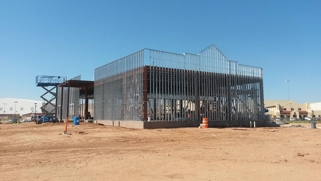 "CANNON AIR FORCE BASE, N.M. – A satellite dining facility that is in the ""erection of structural steel and metal framing stages."" This facility will provide 900 meals daily to enlisted personnel. Photo by James Vigil, Aug. 12, 2015. This was a 2016 Photo Drive entry."