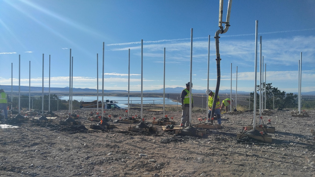 COCHITI LAKE, N.M. – Workers construct the framework for a photovoltaic electric generation system at the project, Sept. 26, 2016. Photo by Erin Larivee. This was a 2016 Photo Drive entry.