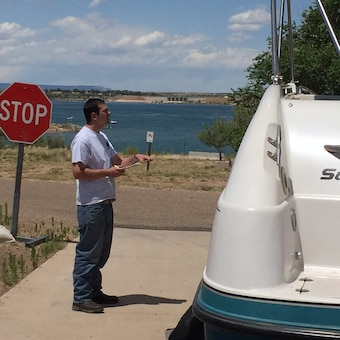 CONCHAS LAKE, N.M. – During the busy Memorial Day Weekend, Shawn Blake, a District employee at Abiquiu Lake, volunteered with boat inspections at the Corps' boat ramp here at Conchas. Photo by Toni Brown, May 28, 2016. This was a 2016 Photo Drive entry.