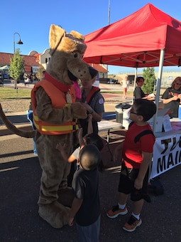 TUCUMCARI, N.M. – Bobber the water safety dog attends the Fired Up event here along with Conchas park ranger Taylor Atwood, Sept. 24, 2016. Bobber talked to many people during the event about the importance of always wearing a life jacket when near the water. Photo by Nadine Carter. This was a 2016 Photo Drive entry.