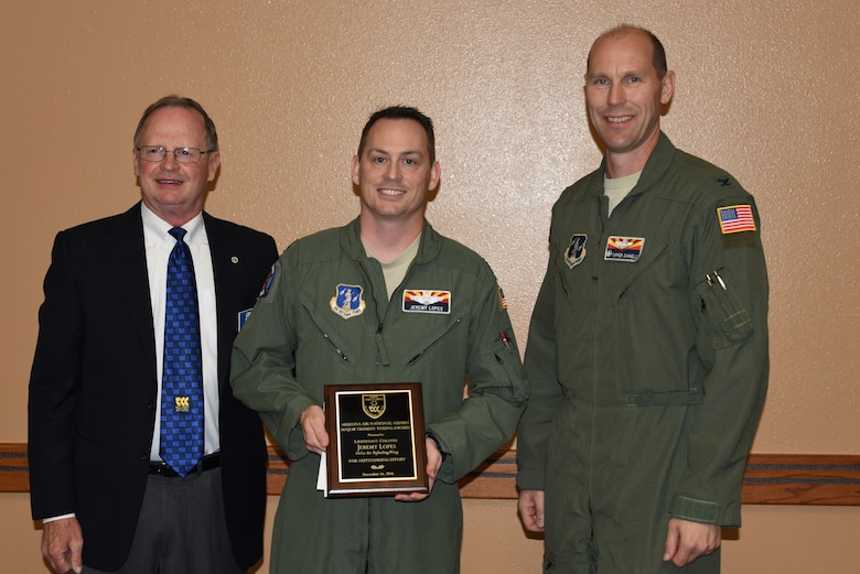 Cliff Jones, Tempe Military Affairs Committee member, and U.S. Air Force Col. Troy Daniels, 161st Air Refueling Wing commander, present the Maj. Truman Young award to Lt. Col. Jeremy Lopes during a ceremony Nov. 15, 2016 at the wing. (U.S. Air National Guard photo by Master Sgt. Kelly Deitloff)