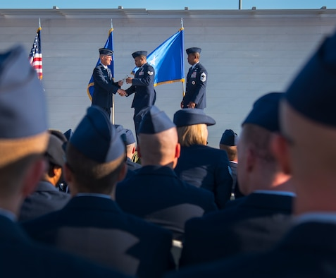 An Airman receives a certificate from Brig. Gen. Christopher Azzano, the 96th Test Wing commander, during a Community College of the Air Force graduation ceremony at Eglin Air Force Base, Fla., Nov. 16.  More than 300 Airmen from Eglin and Duke Field were honored at this year's event. (U.S. Air Force photo/Samuel King Jr.)