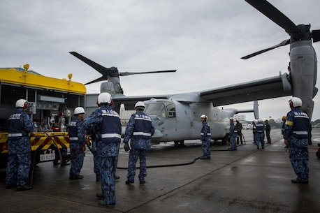 A MV-22B Osprey tiltrotor aircraft from Marine Medium Tiltrotor Squadron (VMM) 262, 31st Marine Expeditionary Unit, is refueled by Japan Maritime Self-Defense Force (JMSDF) members at Oruma Air Base, Nagasaki, Japan, Nov. 18, 2016. The aircraft flew from the island of Okinawa, conducted simulated humanitarian aid with the JMSDF at multiple locations and was refueled by JMSDF personnel before returning to Okinawa. The aircraft also conducted a passenger exercise carrying Sasebo Mayor Norio Tomonaga and the Assemblymen of Defense for Sasebo City. (U.S. Marine Corps photo by Cpl. Darien J. Bjorndal, 31st Marine Expeditionary Unit/ Released)