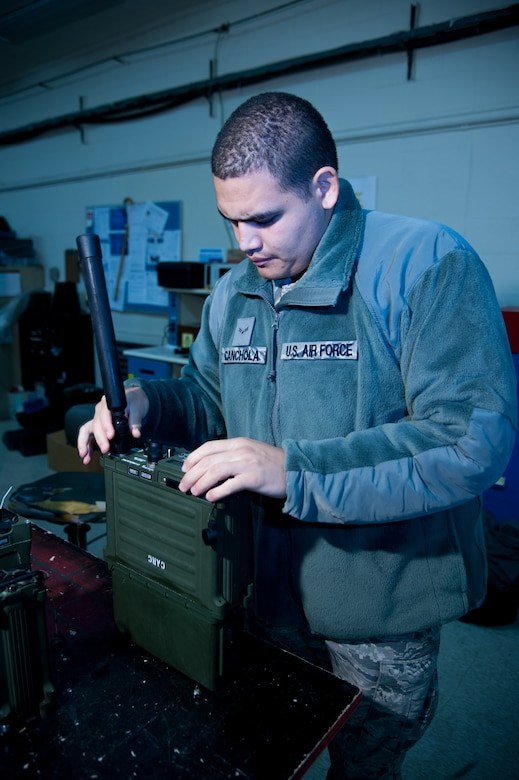 U.S. Air Force Airman 1st Class Sonny Canchola, 51st Communications Squadron radio frequencies transmissions system technician, assembles a PRC-117F Multiband Manpack Radio at Osan Air Base, Republic of Korea, Nov. 17, 2016. Canchola helps maintain Osan's land radios to ensure base-wide communications. (U.S. Air Force photo by Staff Sgt. Jonathan Steffen)