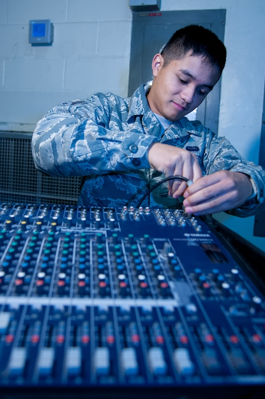U.S. Air Force Airman 1st Class Ryan Vita, 51st Communications Squadron radio frequencies transmissions system technician, plugs audio cables into a soundboard at Osan Air Base, Republic of Korea, Nov. 17, 2016. The transmissions systems flight maintains and operates the public address systems, providing dependable audio systems to base events . (U.S. Air Force photo by Staff Sgt. Jonathan Steffen)