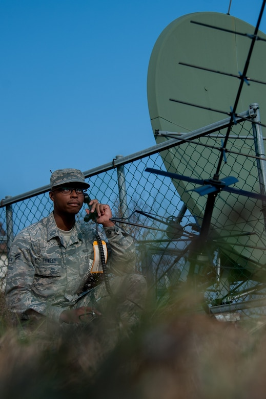 U.S. Air Force Airman 1st Class Demarius Fowler, 51st Communications Squadron radio frequencies system technician, system checks an AV-2040-3 tactical satellite communication antenna at Osan Air Base, Republic of Korea, Nov. 17, 2016. Fowler is part of the transmissions systems flight, which maintains radios frequencies and public address systems. (U.S. Air Force photo by Staff Sgt. Jonathan Steffen)