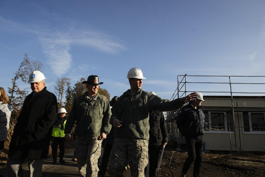 Col. Joe Mcfall, 52nd Fighter Wing commander, center left, and Chief Master Sgt. Edwin Ludwigsen, 52nd FW command chief, center right, tour around the new modular buildings being built for the elementary school on Spangdahlem Air Base, Germany, Nov. 14, 2016. The design and execution of the elementary school expansion project was a collaborative effort between Depart of Defense Education Activity, school leadership and 52nd CES. (U.S. Air Force photo by Staff Sgt. Jonathan Snyder)